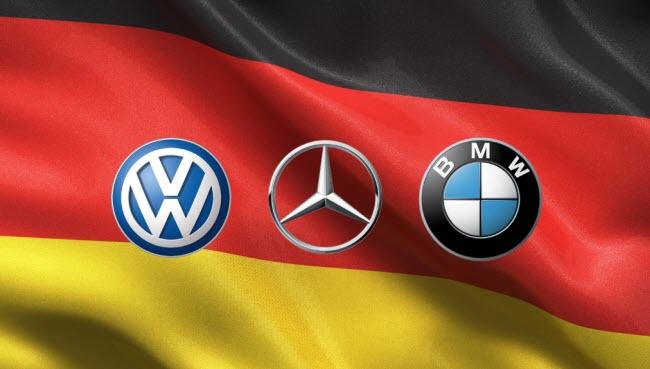 логотипы основных немецких автопроизводителей на фоне флага Германии